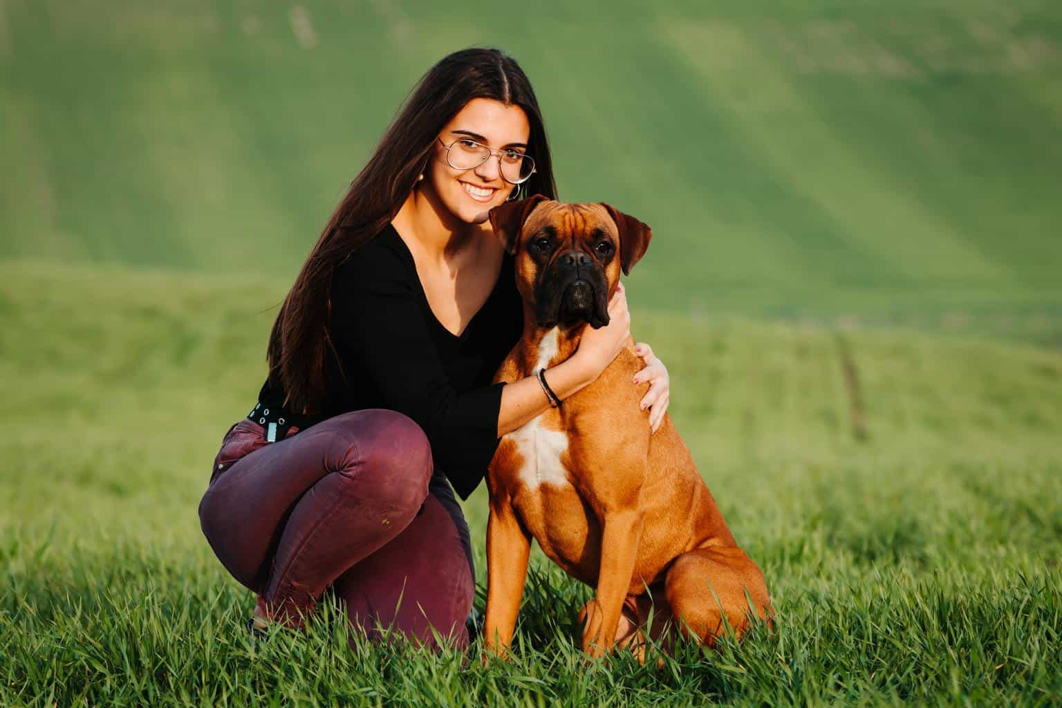 Beautiful woman playing with her dog. Outdoor portrait.
