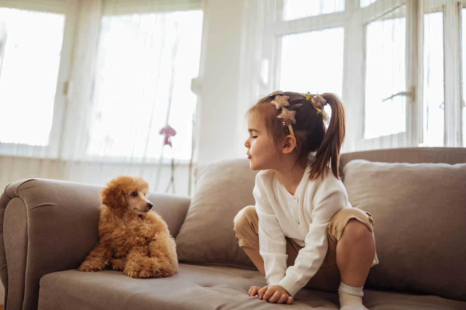 Playing with her new puppy